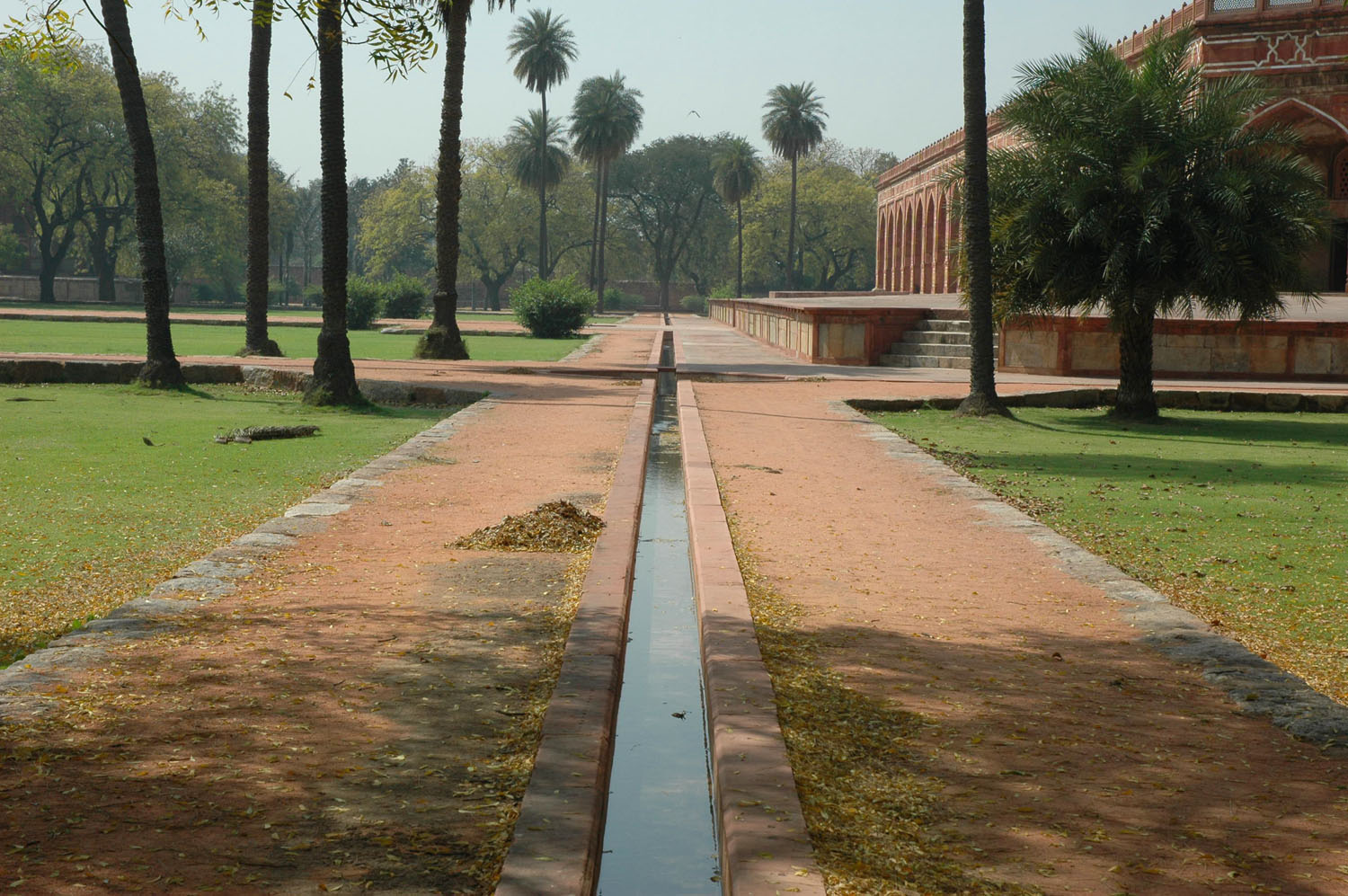Water flow in trough surrounded by palm, Humayun's Tomb complex, New Delhi, 28 March, 2007, photograph by Gordon Brent Ingram
